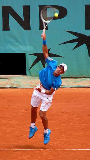 Photo of Novak Djokovic serving at the French Open: CC-y.caradec